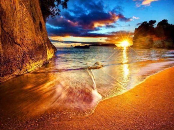 nz cathedral cove beach sunrise